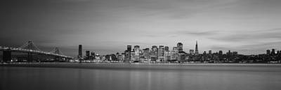 Bay Bridge Photograph - Suspension Bridge With City Skyline by Panoramic Images