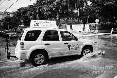 Suv Driving Through Streets Flooded By Heavy Rainfall Key West Florida Usa Print by Joe Fox