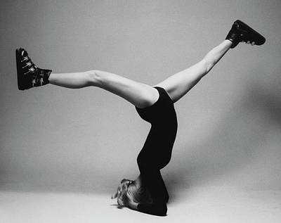 Black And White Photograph - Suzy Chaffee Standing On Her Head by Isi Veleris