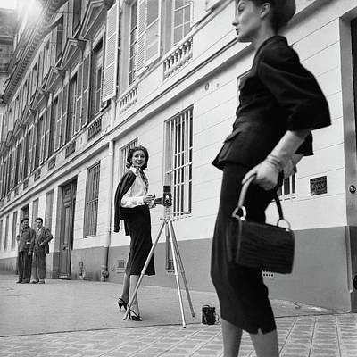 1950s Fashion Photograph - Suzy Parker Photographing A Model In Front by Jacques Boucher