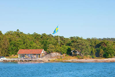 Flagpole Photograph - Sweden, Stockholm - House On Island by Panoramic Images