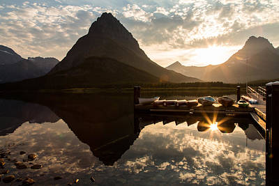 Swiftcurrent Lake Boats Reflection And Flare Print by John Daly