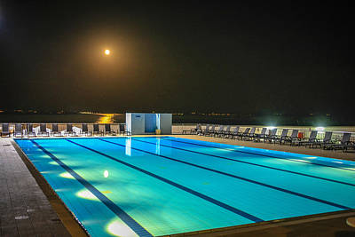 Kim Fearheiley Photography Royalty Free Images - Swimming Moon Royalty-Free Image by Chris Smith