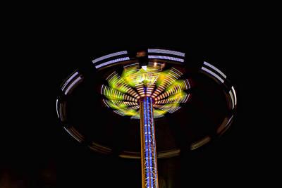 Swing Ride At Night Art Print by Deb Fruscella