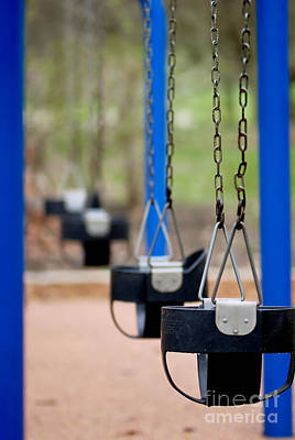 Swings In A Row Shallow Dof Art Print by Amy Cicconi