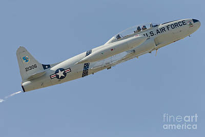 Jet Star Photograph - T-33 Shooting Star Flying by Phil Wallick