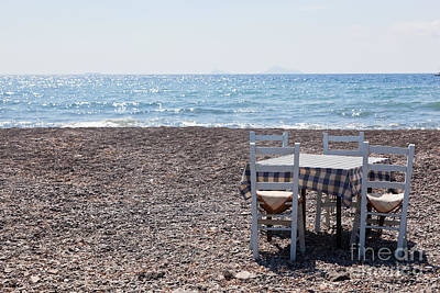 Resort Photograph - Table With Chairs On The Beach Tavern In Greece Santorini by Michal Bednarek