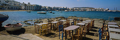 Tables And Chairs In A Cafe, Greece Art Print by Panoramic Images
