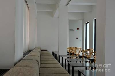 Photograph - Tables Sofa And Cane Chairs In Modern Minimalist Restaurant Setting by Imran Ahmed