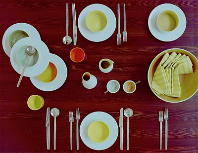 Tableware Set On A Wooden Table Art Print by Romulo Yanes