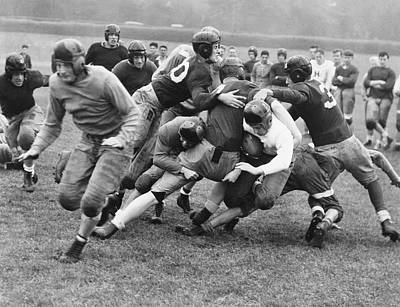 High School Sports Photograph - Tackled In The Football Line by Underwood Archives
