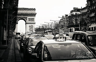 Photograph - Taxis On Champs-elysees by John Rizzuto