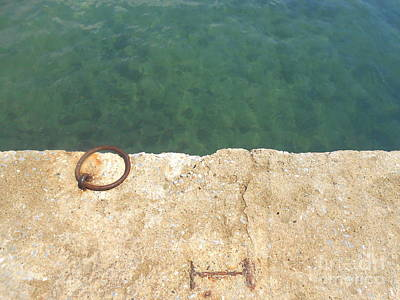 Photograph - Teal Waters And A Rusty Ring On A Dock by Ioanna Papanikolaou
