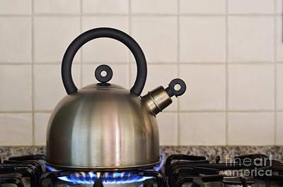 Teapot On Gas Stove Burner Art Print by Sami Sarkis