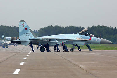 Photograph - Technicians Pushing A Su-35s Jet by Artyom Anikeev