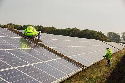 Technicians Work On Wymeswold Solar Farm Art Print by Ashley Cooper