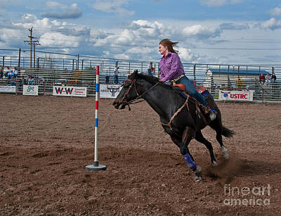Photograph - Teen Cowgirl Pole Racing On Horse At Rodeo by Valerie Garner