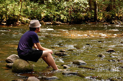 Wall Art - Photograph - Teen Sitting On River Rocks by Susan Montgomery