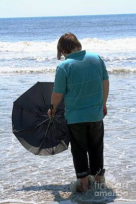 Photograph - Teen With Umbrella Facing The Ocean by Susan Stevenson