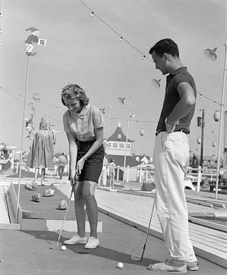 Putt Photograph - Teenage Couple Playing Miniature Golf by H. Armstrong Roberts/ClassicStock