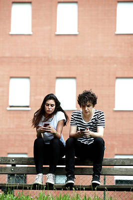 Teenage Couple Using Smart Phones Art Print by Mauro Fermariello