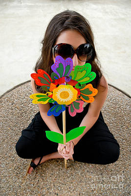 Teenage Girl Hiding Behind Toy Flower Print by Amy Cicconi