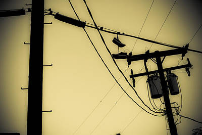 Black And White Photograph - Telephone Pole And Sneakers 9 by Scott Campbell