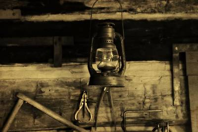 Old Cabins Photograph - That Old Lantern by Dan Sproul
