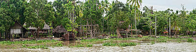 Papua New Guinea Photograph - Thatched Roof Houses On The Bank by Panoramic Images