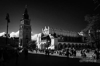 The 16th Century Cloth Hall Sukiennice Building And 13th Century  Gothic Town Hall Tower With Tourists In Rynek Glowny Town Square Krakow Art Print by Joe Fox