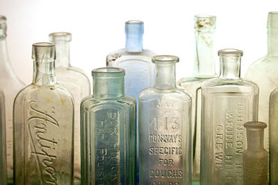 Medicine Bottle Photograph - The Ages Reflected In Glass by Holly Kempe