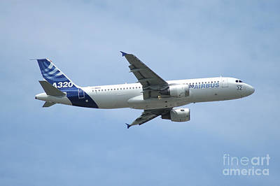 Transportation Royalty-Free and Rights-Managed Images - The Airbus A320 In Flight Over Paris by Riccardo Niccoli