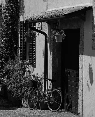 Photograph - The Bicycle Under The Porch by Dany Lison