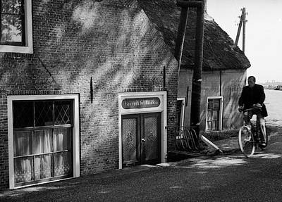 Photograph - The Bike Rider by Cornelis Verwaal