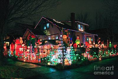 Photograph - The Christmas Inflatables House 2010 by Chris Anderson