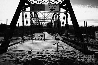 the closed old traffic bridge over the south saskatchewan river in winter downtown Saskatoon Saskatc Print by Joe Fox