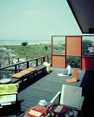 Tableware Photograph - The Deck Of A Beach House by George De Gennaro