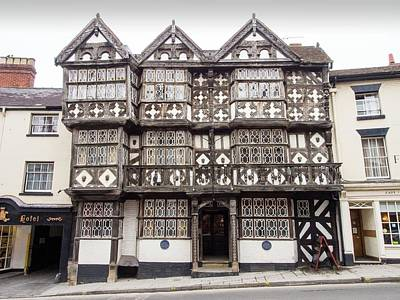 Wood Carving Photograph - The Feathers Hotel In Ludlow by Ashley Cooper