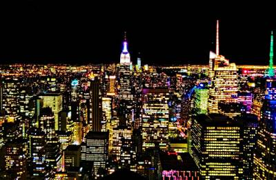 Skylines Royalty-Free and Rights-Managed Images - The Glow Of The New York City Skyline by Dan Sproul