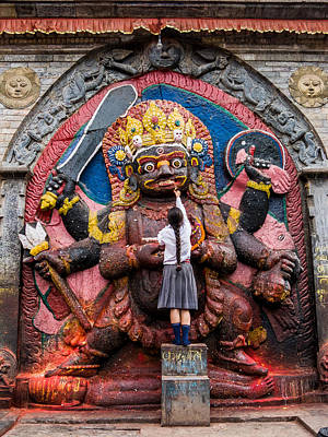 Photograph - A Nepali School Girl Offers A Butter Lamp To The Fearsome Kala Bhairava by Nila Newsom