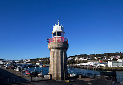 Fishing Harbour Photograph - The Lighthouse And Fishing Harbour by Panoramic Images