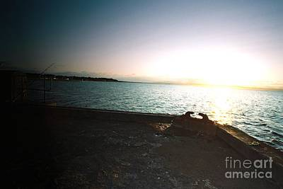 The Lonely Fisherman In The Warmth Of The Setting Sun Art Print