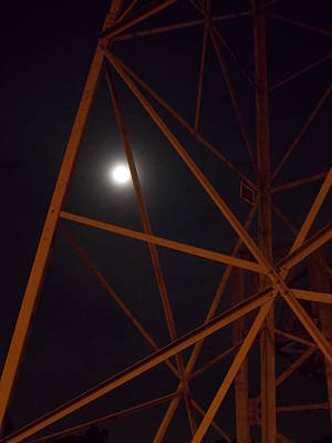 Photograph - The Moon Peeks Out Its Head by Guy Ricketts