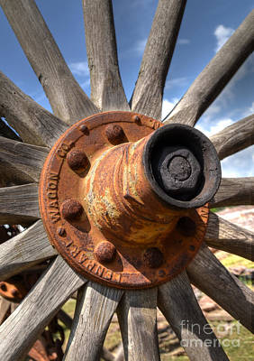 Photograph - The Old Wagon Wheel by Kathy Baccari