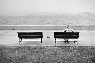 The Pigeon And The Man Print by Ilker Goksen