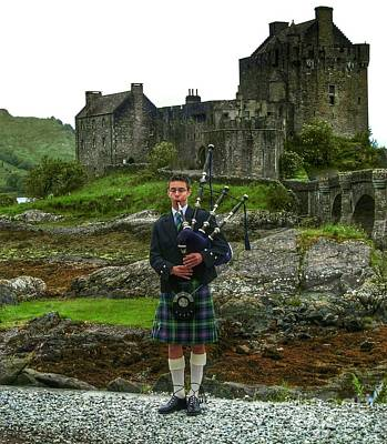 Priska Wettstein Pink Hues Royalty Free Images - The Piper at Eilean Donan Castle Royalty-Free Image by Joan-Violet Stretch