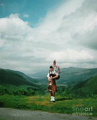 Photograph - The Piper At The Great Glen by Joan-Violet Stretch