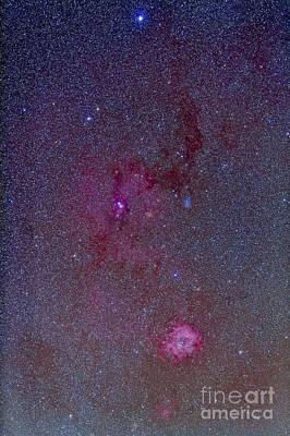 The Rosette Nebula With Nebulosity Art Print by Alan Dyer