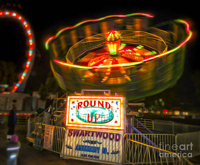 Photograph - The Round Up Carnival Ride At Night by Gregory Dyer