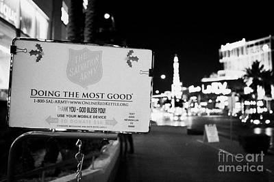 Salvation Army Photograph - the salvation army christmas collection point on the Las Vegas boulevard Nevada USA by Joe Fox